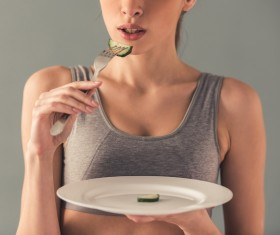 Eat cucumber to lose weight of a woman Stock Photo