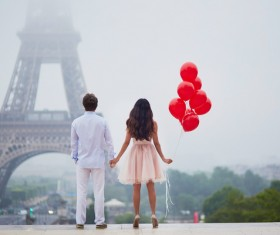 Eiffel Tower in front of a couple holding hands HD picture