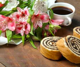Espresso bean bread and flowers Stock Photo