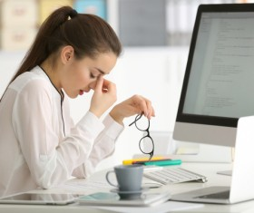 Eyes closed rest of female programmers Stock Photo
