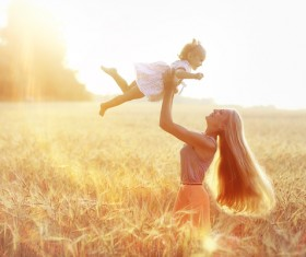 Happy mother and child in the wheat field HD picture