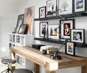 His study desk and wall photos Stock Photo