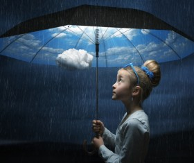 Little girl holding the magic umbrella Stock Photo