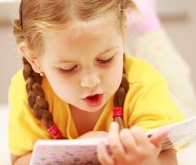 Little girl reading Stock Photo