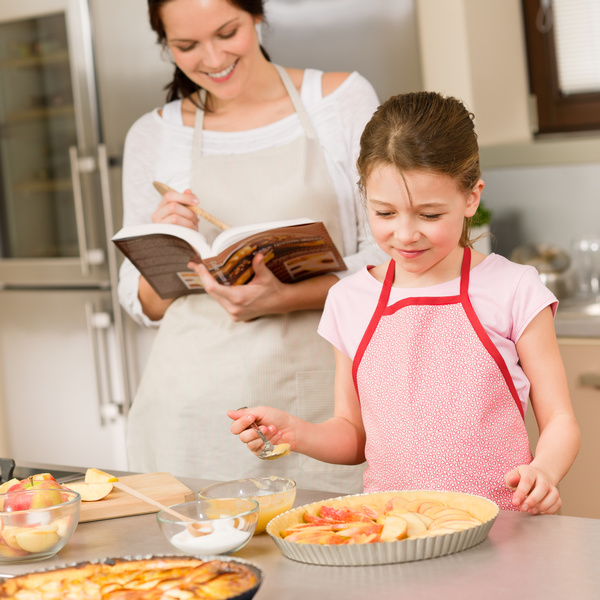 Mother and daughter in the kitchen doing food Stock Photo
