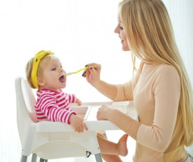 Mother feed baby to eat Stock Photo 01