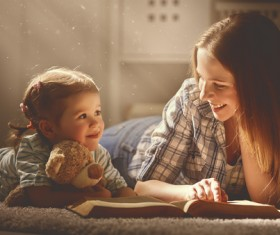 Mother tells the story to the child Stock Photo