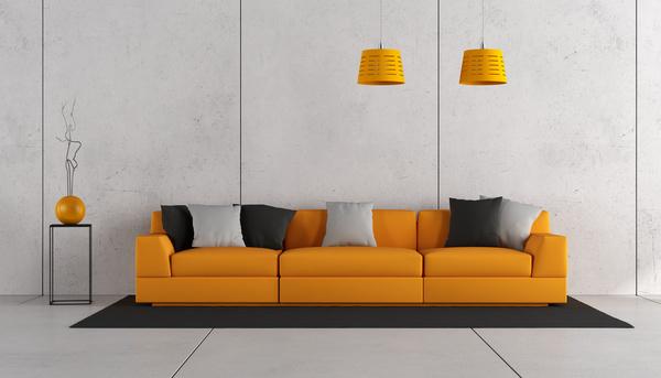 orange sofa with white wall living room stock photo