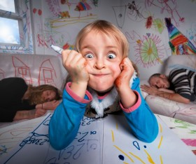 Painting the little girl Funny expression Stock Photo