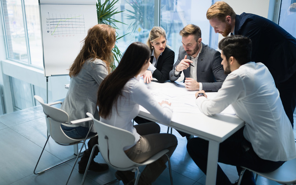 people get together to discuss the business plan stock photo