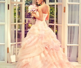 Pink wedding dress with bouquet of bride HD picture