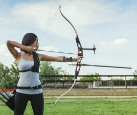 Practice archery female athlete Stock Photo