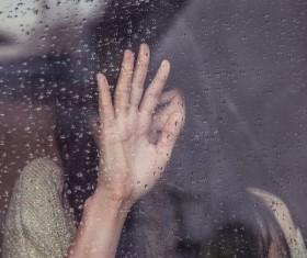 Rainy window Girl Stock Photo
