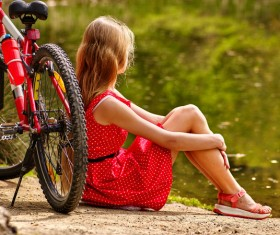 Sit and rest woman with parked bicycles Stock Photo