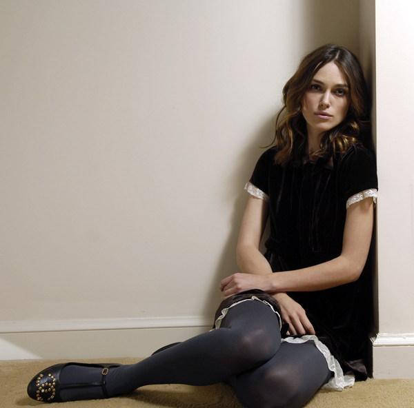 Sitting in the corner sad beauty Stock Photo