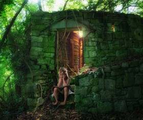 Sitting in the stone house before reading the little girl Stock Photo