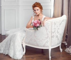 Sitting on the couch with beautiful bride Stock Photo 02