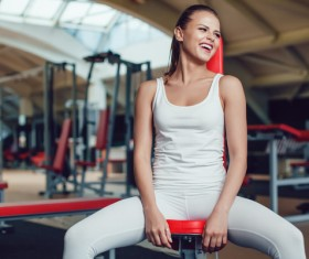 Sitting on the fitness equipment to rest the girl Stock Photo 03