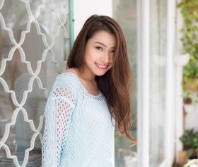 Smile Asian girl in front window HD picture