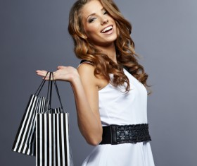 Smiling woman carrying a shopping bag Stock Photo