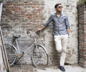 Stylish men with dilapidated bikes HD picture