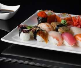 Sushi in a plate on a black background Stock Photo 07