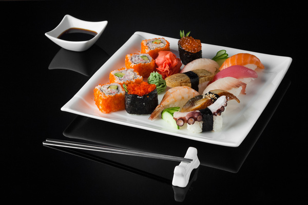 Sushi in a plate on a black background Stock Photo 10