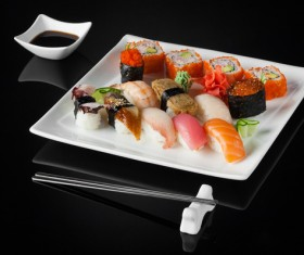 Sushi in a plate on a black background Stock Photo 12