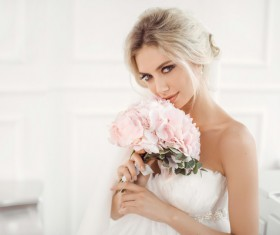 The beautiful bride holds the bouquet Stock Photo 01