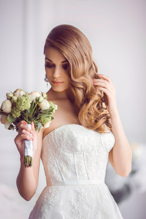 Beautiful bride with wedding bouquet indoors. Wedding fashion