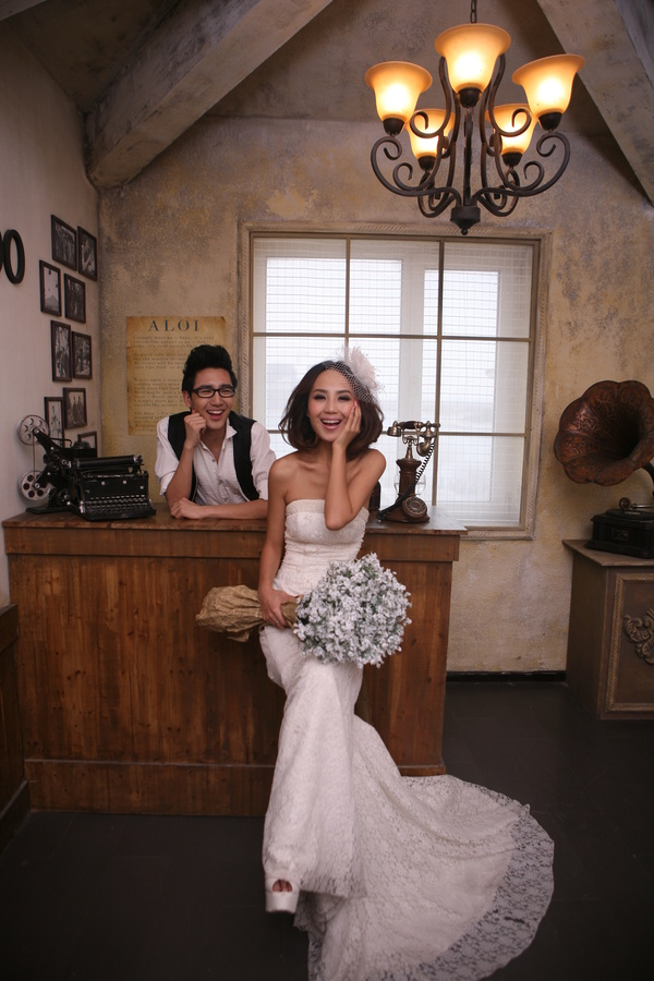 The bride holding the bouquet against the bar Stock Photo