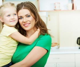 The mother in the kitchen with her daughter Stock Photo