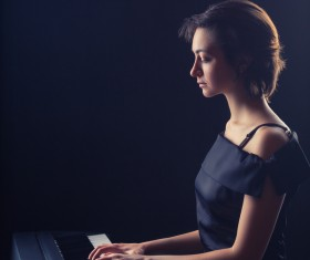 The woman playing the piano Stock Photo