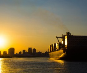 Twilight city with seaside freighter Stock Photo