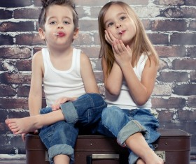 Two children eating a lollipop HD picture