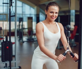 Use of fitness equipment exercise girl Stock Photo 08