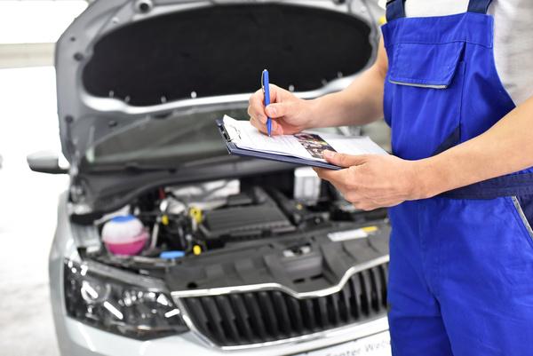 vehicle maintenance staff do car maintenance records stock photo