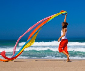 Waving different colors of silk jumping woman HD picture