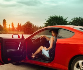 Woman sitting in red sports car Stock Photo 01