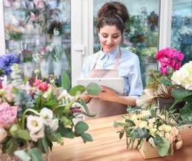 Woman working in florist Stock Photo 01