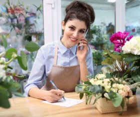 Woman working in florist Stock Photo 03
