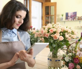 Woman working in florist Stock Photo 06