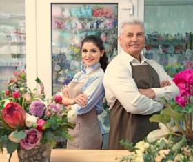 Working women and men in the flower shop Stock Photo 01