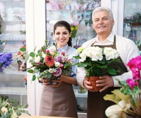 Working women and men in the flower shop Stock Photo 02