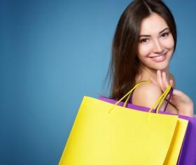 beautiful girl holding a shopping bag Stock Photo
