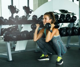 woman holding a dumbbell in the gym Stock Photo 02