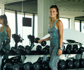 woman holding a dumbbell in the gym Stock Photo 03