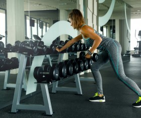 woman holding a dumbbell in the gym Stock Photo 04