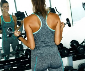 woman holding a dumbbell in the gym Stock Photo 05