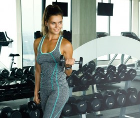 woman holding a dumbbell in the gym Stock Photo 06
